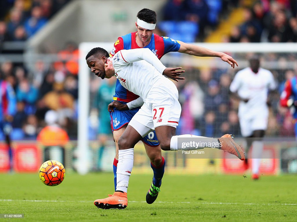 Divock Origi of Liverpool tangles with Scott Dann of Crystal Palace during the Barclays Premier League match between Crystal Palace and Liverpool at Selhurst Park on March 6, 2016 in London, England.