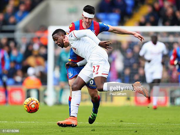 Divock Origi of Liverpool tangles with Scott Dann of Crystal Palace during the Barclays Premier League match between Crystal Palace and Liverpool at...