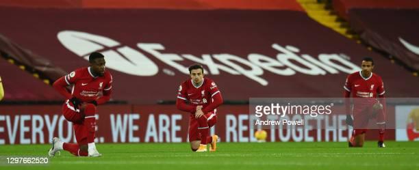Divock Origi of Liverpool with Xherdan Shaqiri of Liverpool and Joel Matip of Liverpool before the Premier League match between Liverpool and Burnley...