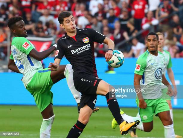 Divock Origi of Wolfsburg and Dominik Kohr of Leverkusen battle for the ball during the Bundesliga match between Bayer 04 Leverkusen and VfL...
