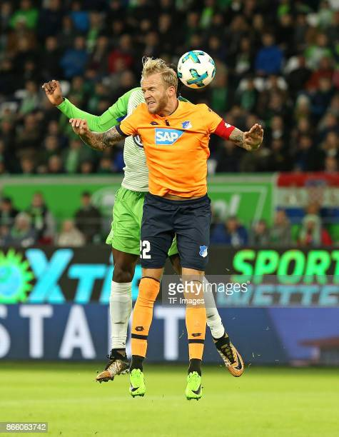 Divock Origi of Wolfsburg and Kevin Vogt of Hoffenheim battle for the ball during the Bundesliga match between VfL Wolfsburg and TSG 1899 Hoffenheim...