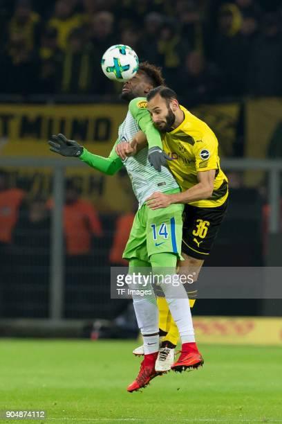 Divock Origi of Wolfsburg and Oemer Toprak of Dortmund battle for the ball during the Bundesliga match between Borussia Dortmund and VfL Wolfsburg at...