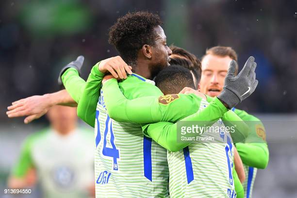 Divock Origi of Wolfsburg celebrates with his team after he score a goal to make it 10 during the Bundesliga match between VfL Wolfsburg and VfB...
