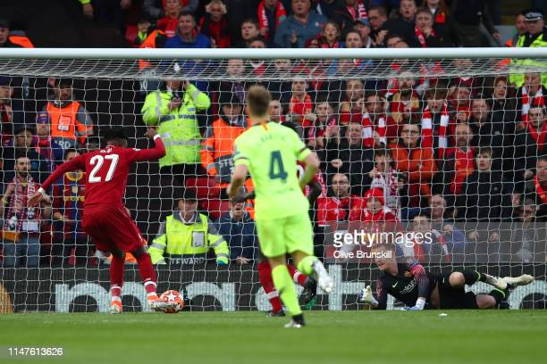 Divock Origi scores his team's first goal during the UEFA Champions League Semi Final second leg match between Liverpool and Barcelona at Anfield on...
