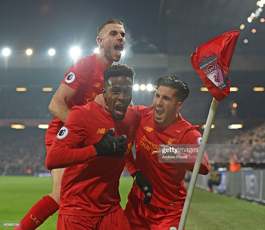 Divock Origi Scores the opener for Liverpool and celebrates during the Premier League match between Liverpool and Sunderland at Anfield on November 26, 2016 in Liverpool, England.