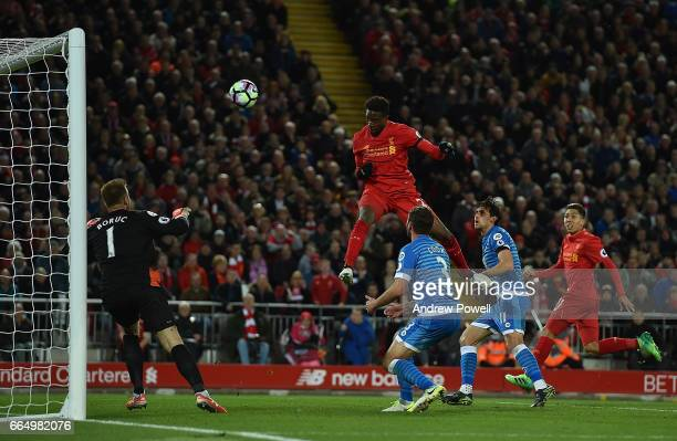 Divock Origi scores to put Liverpool In the lead during the Premier League match between Liverpool and AFC Bournemouth at Anfield on April 5 2017 in...