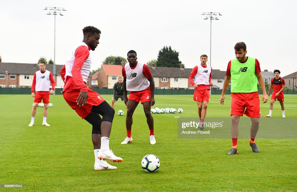 Divock Origi, Sheyi Ojo and Perdro Chirivella of Liverpool during a training session at Melwood Training Ground on July 12, 2018 in Liverpool, England.