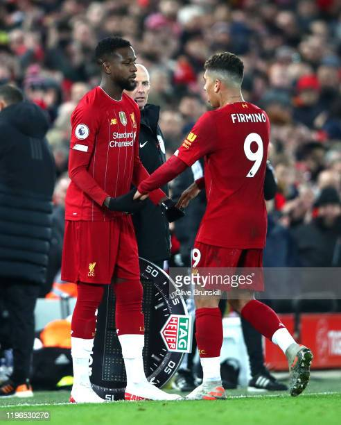 Divok Origi replaces Roberto Firminho of Liverpool during the Premier League match between Liverpool FC and Wolverhampton Wanderers at Anfield on...