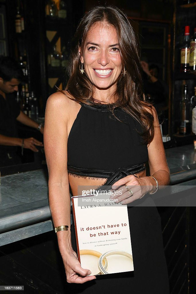 Laura wasser book party photos and images getty images divorce attorney laura wasser poses with a copy of her new book it doesn solutioingenieria Choice Image