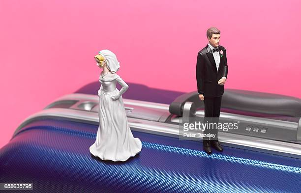 divorce honeymoon couple on suitcase - honeymoon stock pictures, royalty-free photos & images