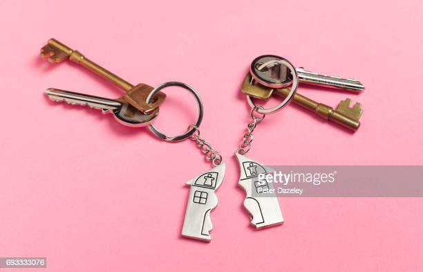 divorce house keys on pink - divorce stock pictures, royalty-free photos & images