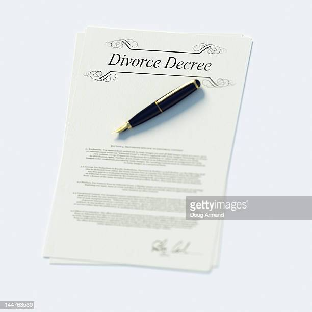 Divorce papers in English and pen