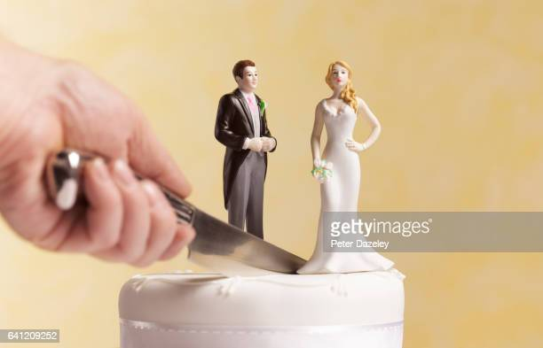 divorce wedding cake with knife and mans hand - figurine stock pictures, royalty-free photos & images