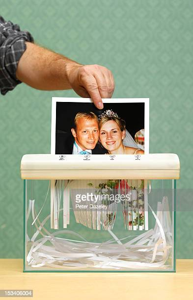 Divorced husband shredding wedding photo