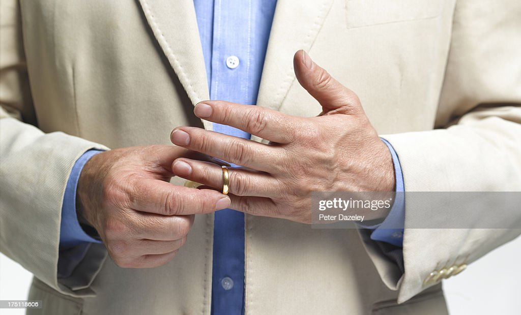 Divorced Man Taking Off Wedding Ring Stock Photo Getty Images
