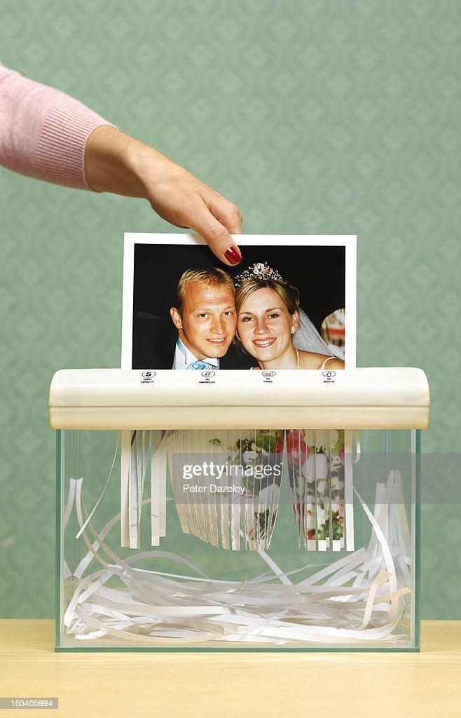 divorced wife shredding wedding photo : Stock Photo
