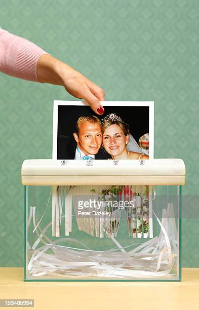 divorced wife shredding wedding photo