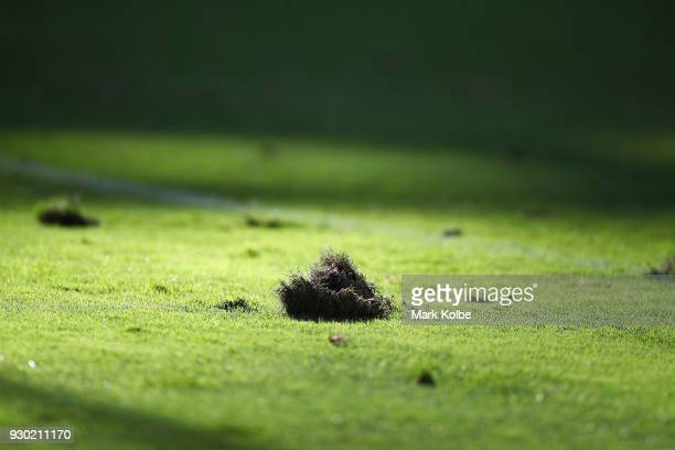 A divot is seen on the pitch surface during the round one NRL match between the Wests Tigers and the Sydney Roosters at ANZ Stadium on March 10 2018...