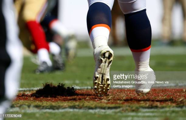 A divot of turf at midfield can be seen below Denver Broncos' Ryan Miller during their game against the San Francisco 49ers in the fourth quarter for...