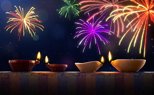 Diwali celebration with diya lamps and fireworks 811762526