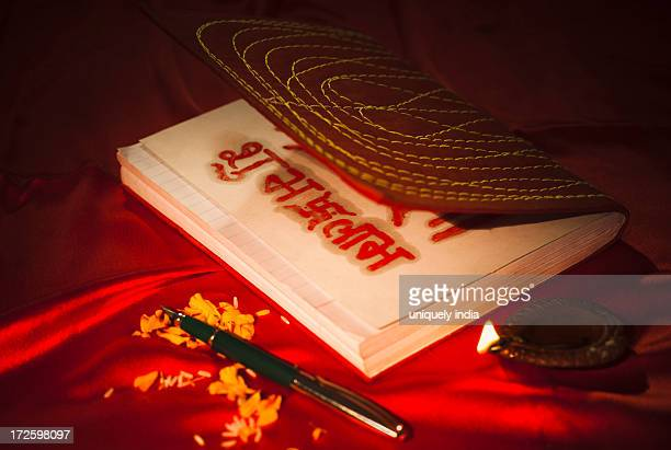 diwali diya and a pen with ledger book during diwali festival - lakshmi puja stock photos and pictures
