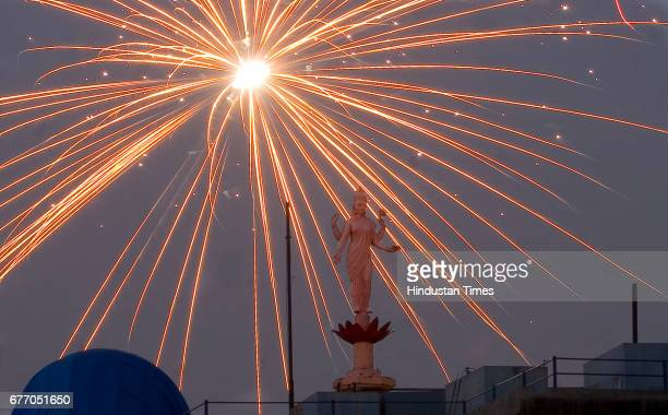 Diwali Festival Firecrackers An eye catching light out of the cracker beaming over the head of goddess Laxmi opposite the Bombay Stock Exchange BSE...