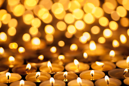 Diwali Festival of Lights. Beautiful candlelight. Selective focus on foreground of many burning tealight candles. 860650936
