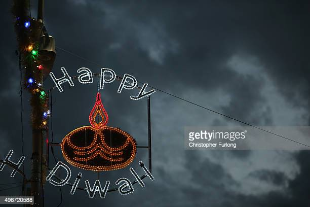 Diwali lights illuminate the Golden Mile as people gather to celebrate the Hindu festival of Diwali on November 11 2015 in Leicester United Kingdom...