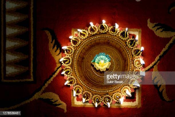 diwali lights on colorful background. - diwali decoration stock pictures, royalty-free photos & images