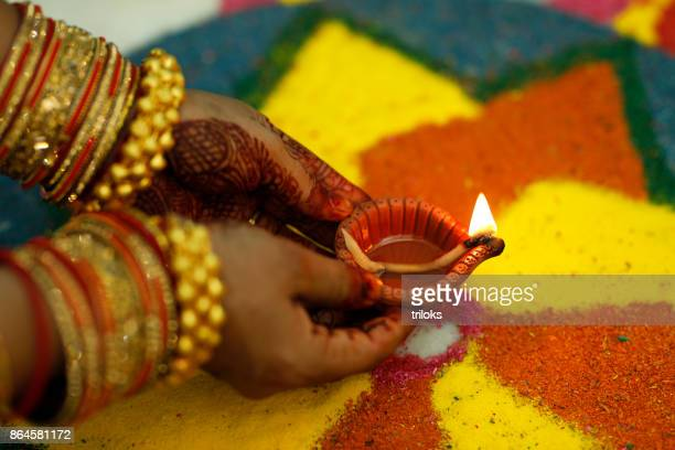 diwali oil lamp lit up at night - rangoli stock pictures, royalty-free photos & images