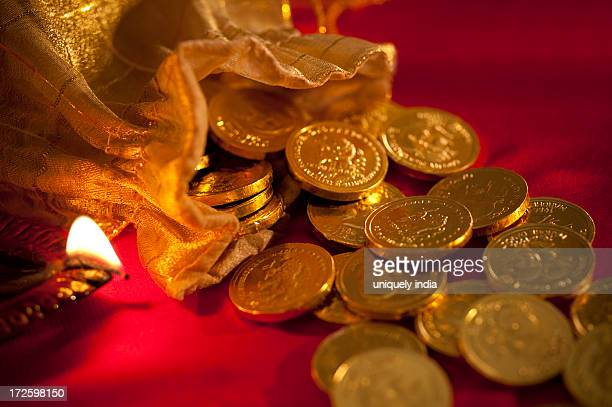 diwali oil lamp with golden coins during diwali festival - goddess lakshmi stock photos and pictures