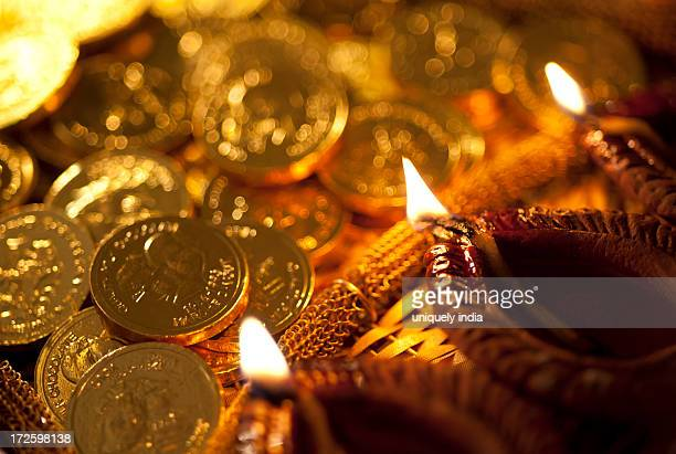Diwali oil lamps with golden coins during Diwali festival