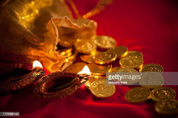 diwali oil lamps with golden coins during diwali festival - goddess lakshmi stock photos and pictures