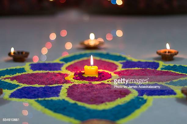 Diwali Rangoli decorated with Diyas & Candle