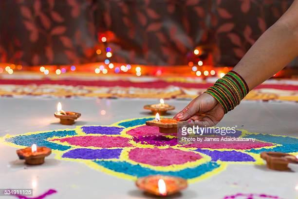 Diwali Rangoli decorated with diyas & candle