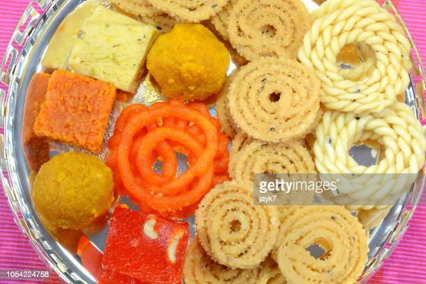 diwali sweets - diwali sweets stock photos and pictures