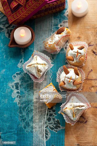 diwali sweets set in rustic indian settings - diwali sweets stock photos and pictures