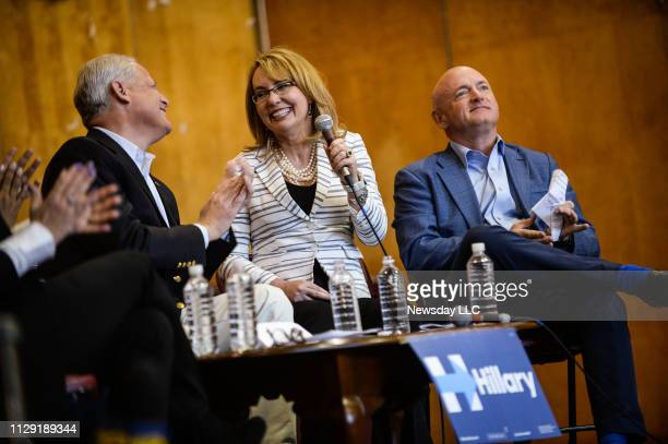 Arizona Congresswoman Gabby Giffords speaks while sitting with her husband astronaut Captain Mark Kelly and New York Congressman Steve Israel as they...