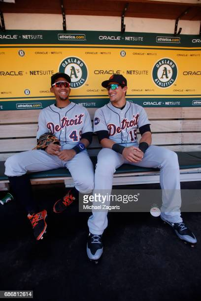 Dixon Machado and Mikie Mahtook of the Detroit Tigers relax in the dugout prior to the game against the Oakland Athletics at the Oakland Alameda...