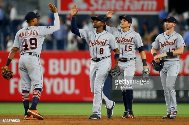 Dixon Machado Justin Upton Mikie Mahtook and Andrew Romine of the Detroit Tigers celebrate after defeating the New York Yankees at Yankee Stadium on...