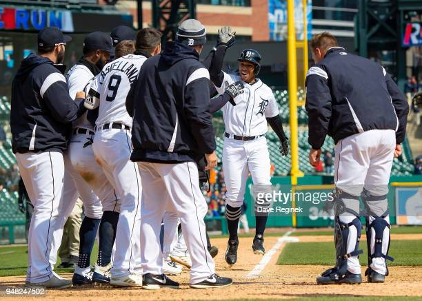 Dixon Machado of the Detroit Tigers hits a walk off home run in the ninth inning against the Baltimore Orioles and celebrates with teammates at home...