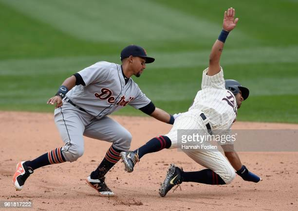 Dixon Machado of the Detroit Tigers tags out Eddie Rosario of the Minnesota Twins after a rundown during the sixth inning of the game on May 23 2018...