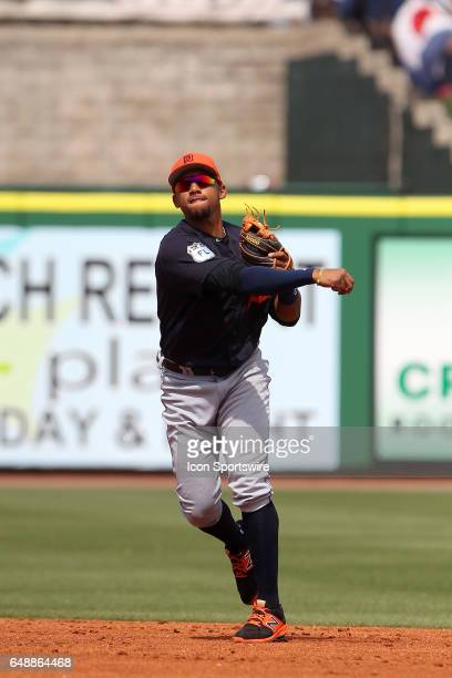 Dixon Machado of the Tigers throws the ball over to first base during the spring training game between the Detroit Tigers and the Philadelphia...