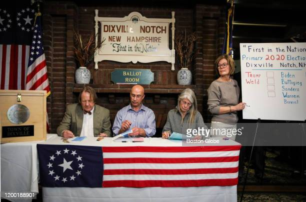 Dixville Notch residents Tom Tillotson Joe Casey Debra Tillotson and Colebrook resident Coralie Stepanian count up the votes while participating in...