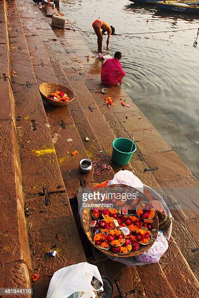 diya and flowers for sale on dashashwamedh ghat of varanasi - manikarnika ghat stock photos and pictures