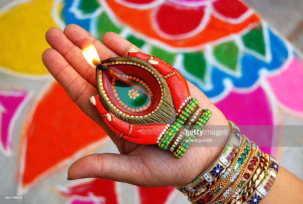 Diya in Hand : Stock Photo