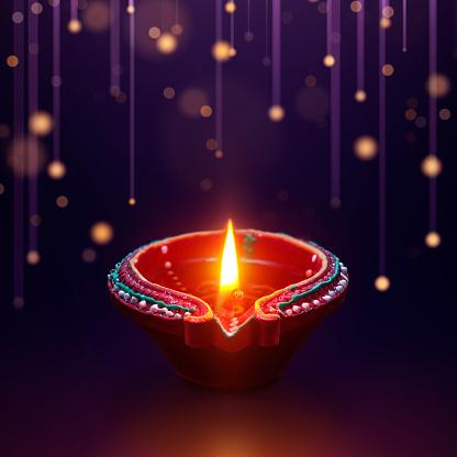 Diya oil lamp with hanging light background, Diwali celebration 1151934236