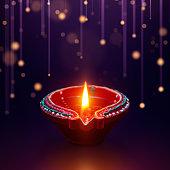 Diya oil lamp with hanging light background, Diwali celebration