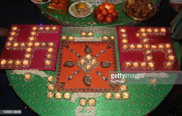 Diyas by a shrine to the Goddess Laxmi during the festival of Diwali at a Hindu temple in Toronto, Ontario, Canada on November 7, 2018.