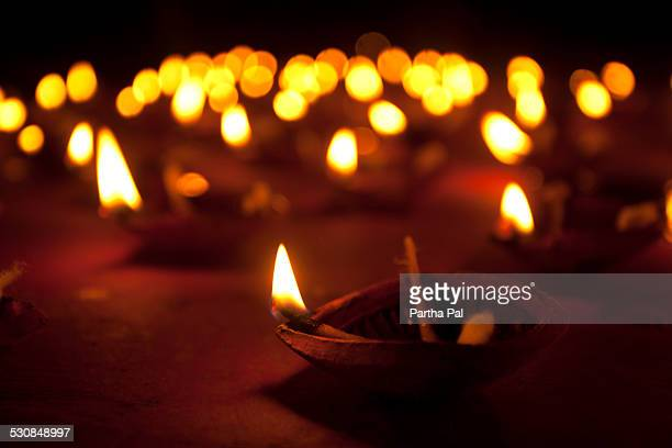 Diyas(clay oil lamps)glowing in kali Puja Festival
